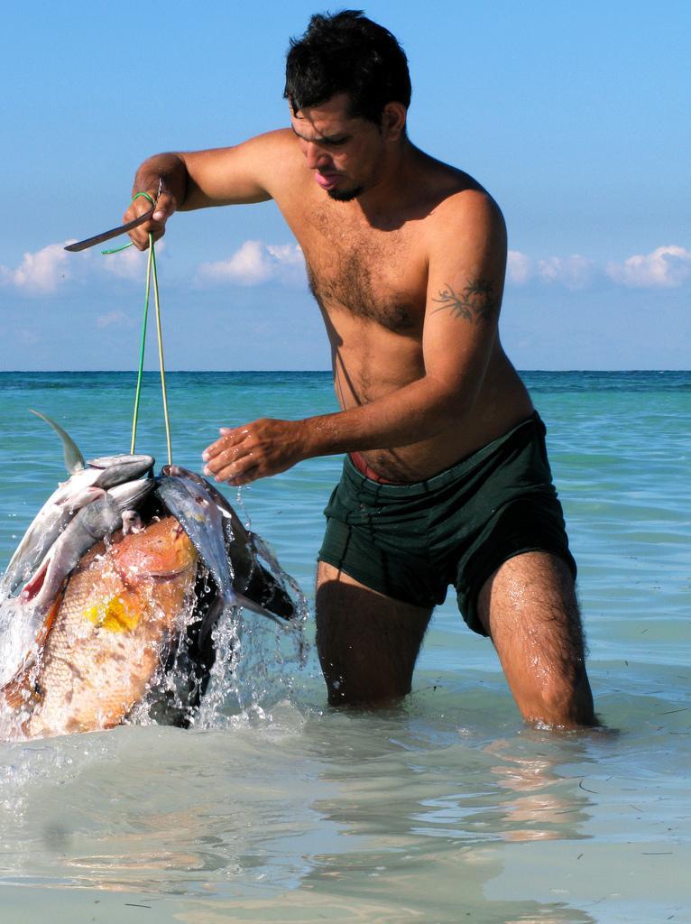 Рыбак на Кайо-Хутиас