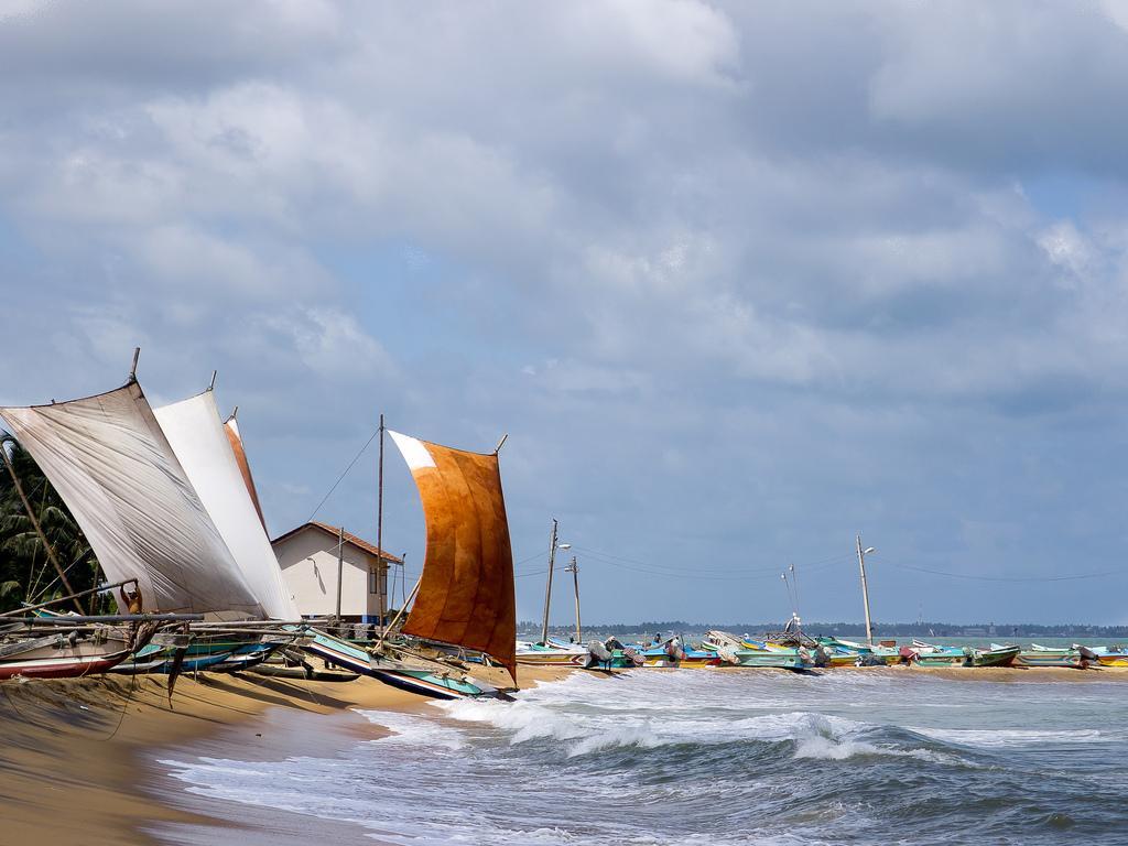 Традиционные шриланкийсие рыбацкие лодки